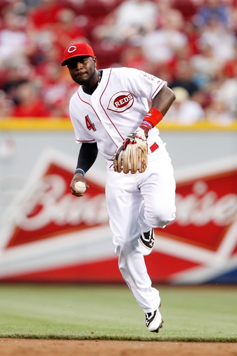 Jun 17, 2013; Cincinnati, OH, USA; Cincinnati Reds second baseman Brandon Phillips (4) makes a play during the third inning against the Pittsburgh Pirates at Great American Ball Park. Mandatory Credit: Frank Victores-USA TODAY Sports