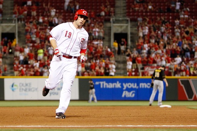 Jun 17, 2013; Cincinnati, OH, USA; Cincinnati Reds first baseman Joey Votto (19) rounds the bases after hitting a home run during the ninth inning against the Pittsburgh Pirates at Great American Ball Park. The Reds defeated the Pirates 4-1. Mandatory Credit: Frank Victores-USA TODAY Sports
