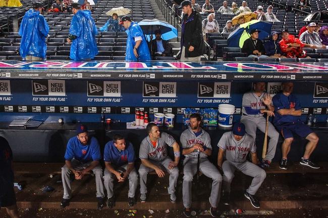 June 17, 2012; Atlanta, GA, USA; New York Mets third baseman David Wright (5) and teammates sit in the dugout during a rain delay before the game against the Atlanta Braves at Turner Field. Mandatory Credit: Daniel Shirey-USA TODAY Sports