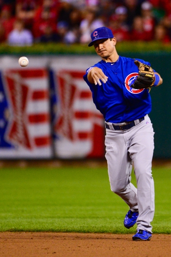 Jun 17, 2013; St. Louis, MO, USA; Chicago Cubs second baseman Darwin Barney (15) throws out a St. Louis Cardinals base runner at Busch Stadium. Mandatory Credit: Scott Rovak-USA TODAY Sports
