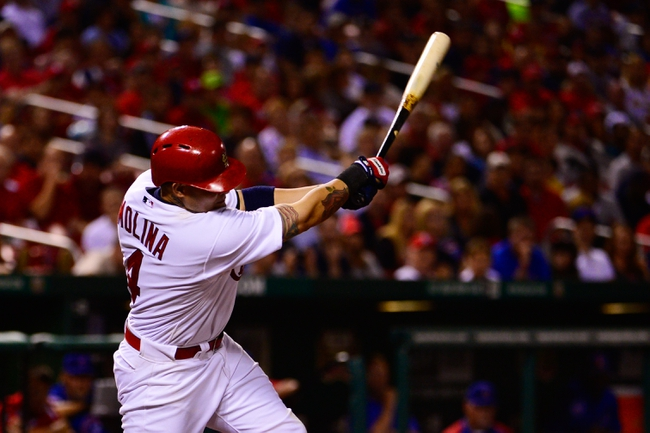 Jun 17, 2013; St. Louis, MO, USA; St. Louis Cardinals catcher Yadier Molina (4) hits a 2 run double against the Chicago Cubs during the fourth inning at Busch Stadium. Mandatory Credit: Scott Rovak-USA TODAY Sports
