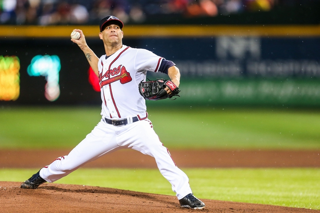 June 17, 2012; Atlanta, GA, USA; Atlanta Braves starting pitcher Tim Hudson (15) pitches in the first inning against the New York Mets at Turner Field. Mandatory Credit: Daniel Shirey-USA TODAY Sports