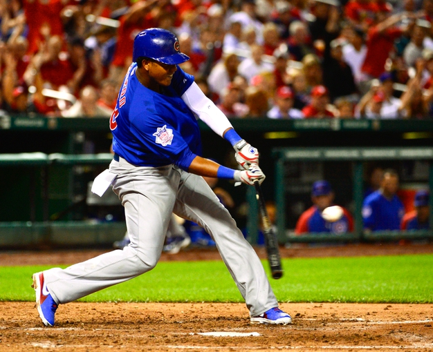 Jun 17, 2013; St. Louis, MO, USA; Chicago Cubs shortstop Starlin Castro (13) gets a hit against the St. Louis Cardinals during the eighth inning at Busch Stadium. Mandatory Credit: Scott Rovak-USA TODAY Sports