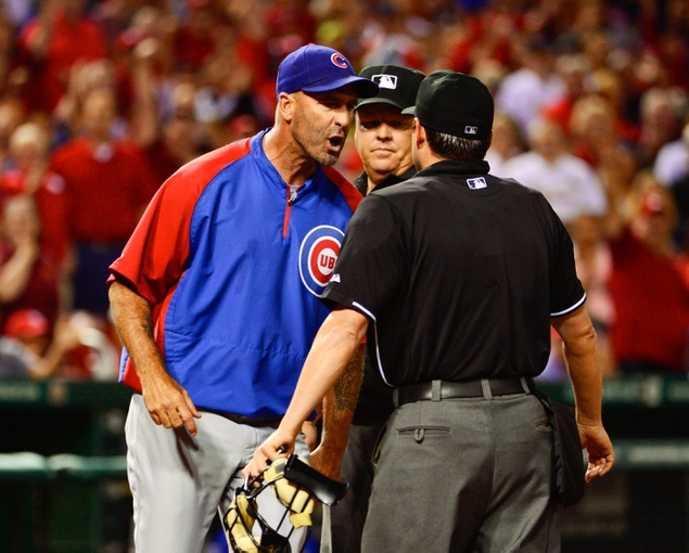 Jun 17, 2013; St. Louis, MO, USA; Chicago Cubs manager Dale Sveum (4) argues with umpire D.J. Reyburn (70) after a call goes to the St. Louis Cardinals during the seventh inning at Busch Stadium. Mandatory Credit: Scott Rovak-USA TODAY Sports