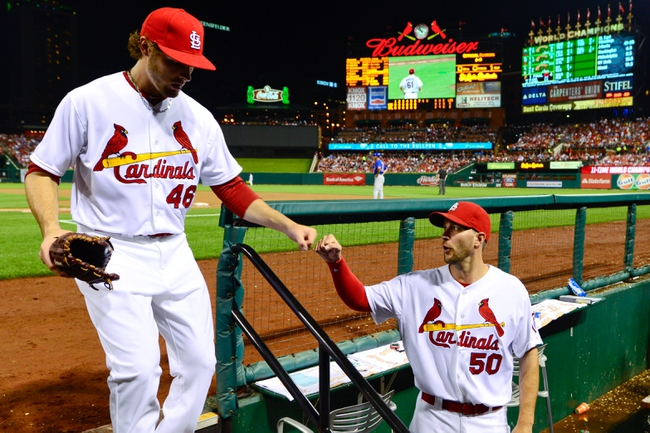 Jun 17, 2013; St. Louis, MO, USA; St. Louis Cardinals relief pitcher Kevin Siegrist (46) is congratulated by  Cardinals pitcher Adam Wainwright (50) after a hitless inning against the Chicago Cubs at Busch Stadium. Mandatory Credit: Scott Rovak-USA TODAY Sports