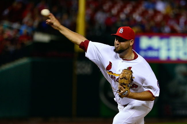 Jun 17, 2013; St. Louis, MO, USA; St. Louis Cardinals relief pitcher Edward Mujica (44) delivers a pitch against the Chicago Cubs at Busch Stadium. The Cardinals defeated the Cubs 5-2. Mandatory Credit: Scott Rovak-USA TODAY Sports