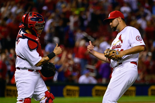 Jun 17, 2013; St. Louis, MO, USA; St. Louis Cardinals relief pitcher Edward Mujica (44) and Cardinals catcher Yadier Molina (4) celebrate their victory over the Chicago Cubs against the Chicago Cubs at Busch Stadium. The Cardinals defeated the Cubs 5-2. Mandatory Credit: Scott Rovak-USA TODAY Sports