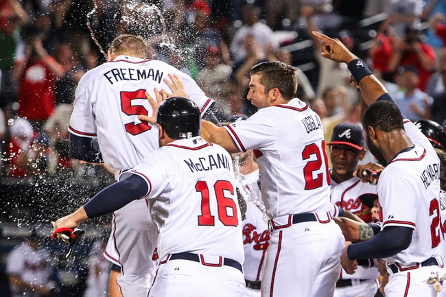 June 17, 2012; Atlanta, GA, USA; Atlanta Braves first baseman Freddie Freeman (5) celebrates a walk off two-run home run with teammates in the ninth inning against the New York Mets at Turner Field. The Braves won 2-1. Mandatory Credit: Daniel Shirey-USA TODAY Sports