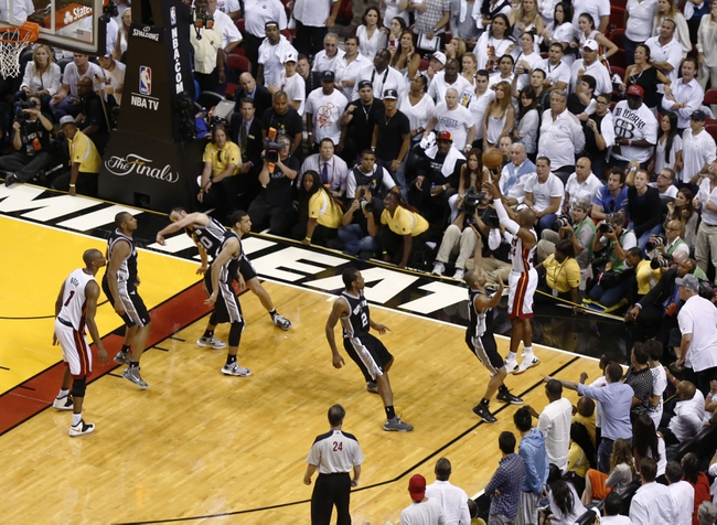Jun 18, 2013; Miami, FL, USA; Miami Heat shooting guard Ray Allen (34) hits the tying three-point shot with 5.2 seconds against the San Antonio Spurs during the fourth quarter of game six in the 2013 NBA Finals at American Airlines Arena.  Mandatory Credit: Robert Mayer-USA TODAY Sports