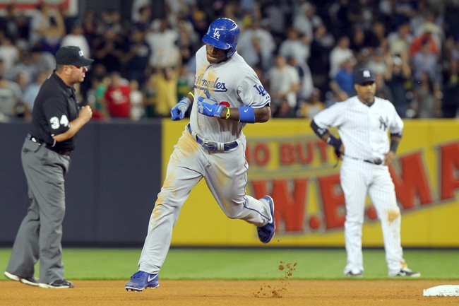 Jun 19, 2013; Bronx, NY, USA; Los Angeles Dodgers right fielder Yasiel Puig (66) rounds second in front of New York Yankees second baseman Robinson Cano (24) after hitting a solo home run against the New York Yankees during the seventh inning of the second game of a doubleheader at Yankee Stadium. Mandatory Credit: Brad Penner-USA TODAY Sports