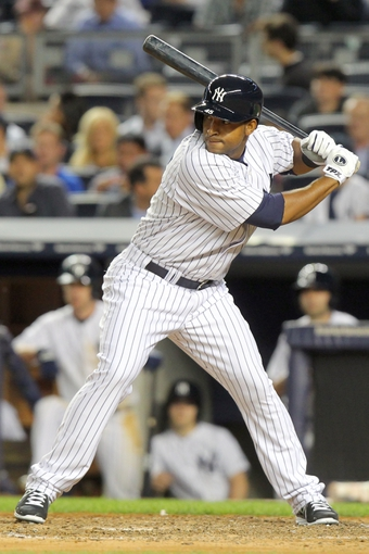 Jun 19, 2013; Bronx, NY, USA; New York Yankees right fielder Zoilo Almonte (45) stands in the batters box as he makes his major league debut against the Los Angeles Dodgers during the ninth inning of the second game of a doubleheader at Yankee Stadium. Mandatory Credit: Brad Penner-USA TODAY Sports