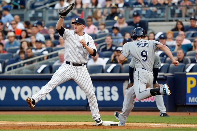 Jun 21, 2013; Bronx, NY, USA;  New York Yankees first baseman Lyle Overbay (55) forces out Tampa Bay Rays right fielder Wil Myers (9) during the second inning at Yankee Stadium.  Mandatory Credit: Anthony Gruppuso-USA TODAY Sports