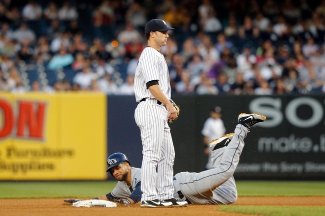 Jun 21, 2013; Bronx, NY, USA;  Tampa Bay Rays first baseman James Loney (21) slides to second on a wild pitch during the fourth inning against the New York Yankees at Yankee Stadium.  Mandatory Credit: Anthony Gruppuso-USA TODAY Sports