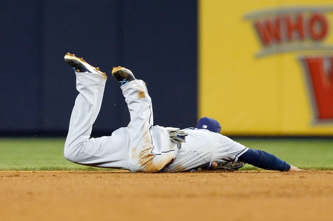 Jun 21, 2013; Bronx, NY, USA; Tampa Bay Rays shortstop Yunel Escobar (11) misses the ball during the fourth inning against the New York Yankees at Yankee Stadium.  Mandatory Credit: Anthony Gruppuso-USA TODAY Sports