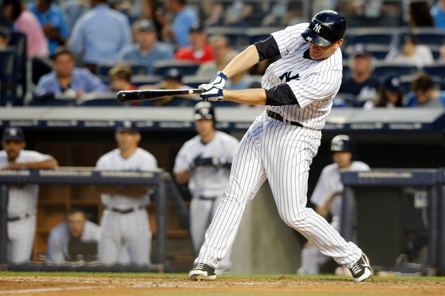 Jun 21, 2013; Bronx, NY, USA; New York Yankees first baseman Lyle Overbay (55) singles to center during the fourth inning against the Tampa Bay Rays at Yankee Stadium.  Mandatory Credit: Anthony Gruppuso-USA TODAY Sports
