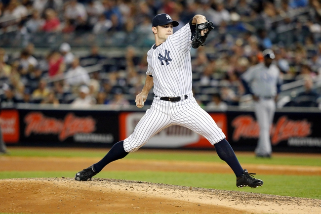 Jun 21, 2013; Bronx, NY, USA;  New York Yankees relief pitcher David Robertson (30) delivers a pitch during the eighth inning against the Tampa Bay Rays at Yankee Stadium.  Yankees won 6-2.  Mandatory Credit: Anthony Gruppuso-USA TODAY Sports