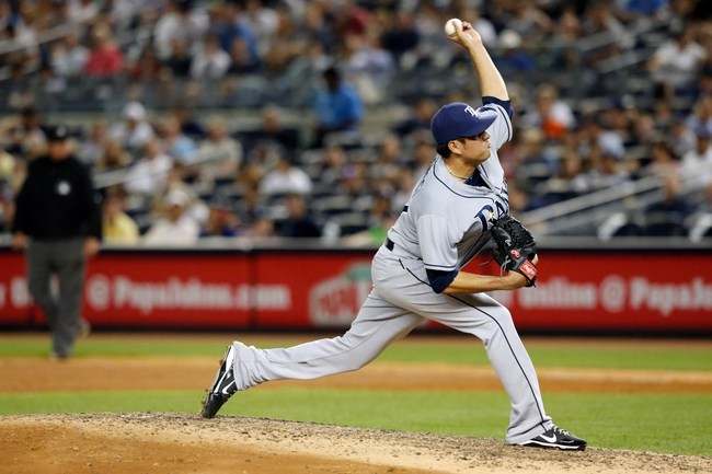 Jun 21, 2013; Bronx, NY, USA; Tampa Bay Rays relief pitcher Cesar Ramos (27) delivers a pitch during the eighth inning against the New York Yankees at Yankee Stadium.  Yankees won 6-2.  Mandatory Credit: Anthony Gruppuso-USA TODAY Sports