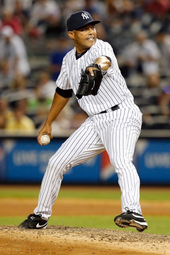 Jun 21, 2013; Bronx, NY, USA;  New York Yankees relief pitcher Mariano Rivera (42) pitches during the ninth inning against the Tampa Bay Rays at Yankee Stadium.  Yankees won 6-2.  Mandatory Credit: Anthony Gruppuso-USA TODAY Sports