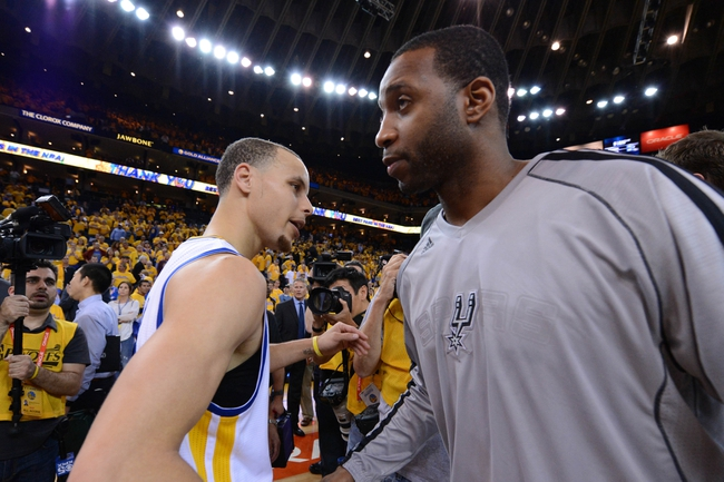 May 16, 2013; Oakland, CA, USA; Golden State Warriors point guard Stephen Curry (30, left) shakes hands with San Antonio Spurs shooting guard Tracy McGrady (1, right) after game six of the second round of the 2013 NBA Playoffs at Oracle Arena. The Spurs defeated the Warriors 94-82.  Mandatory Credit: Kyle Terada-USA TODAY Sports