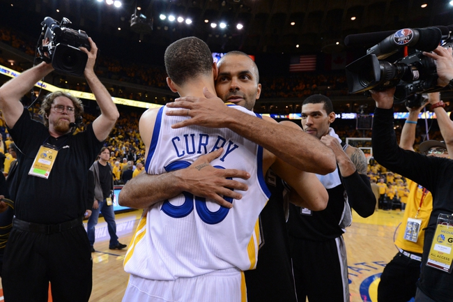 May 16, 2013; Oakland, CA, USA; Golden State Warriors point guard Stephen Curry (30, left) hugs San Antonio Spurs point guard Tony Parker (9, right) after game six of the second round of the 2013 NBA Playoffs at Oracle Arena. The Spurs defeated the Warriors 94-82.  Mandatory Credit: Kyle Terada-USA TODAY Sports