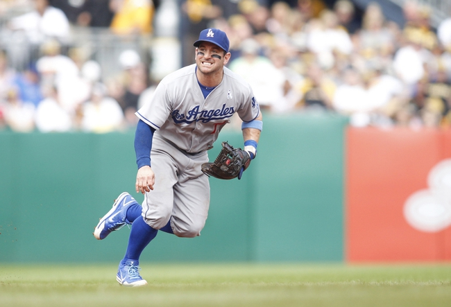 Jun 16, 2013; Pittsburgh, PA, USA; Los Angeles Dodgers second baseman Nick Punto (7) in the field against the Pittsburgh Pirates during the fifth inning at PNC Park. The Pittsburgh Pirates won 6-3. Mandatory Credit: Charles LeClaire-USA TODAY Sports