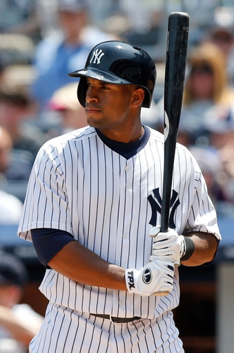 Jun 22, 2013; Bronx, NY, USA; New York Yankees left fielder Zoilo Almonte (45) at bat during the third inning against the Tampa Bay Rays at Yankee Stadium.  Mandatory Credit: Anthony Gruppuso-USA TODAY Sports