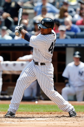 Jun 22, 2013; Bronx, NY, USA;  New York Yankees left fielder Zoilo Almonte (45) singles to center allowing two runners to score during the third inning against the Tampa Bay Rays at Yankee Stadium.  Mandatory Credit: Anthony Gruppuso-USA TODAY Sports