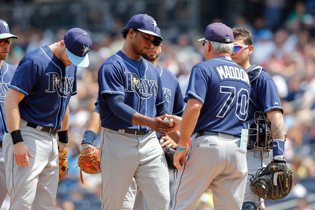 Jun 22, 2013; Bronx, NY, USA;  Tampa Bay Rays manager Joe Maddon (70) relieves starting pitcher Alex Colome (37) during the fifth inning against the New York Yankees at Yankee Stadium.  Mandatory Credit: Anthony Gruppuso-USA TODAY Sports