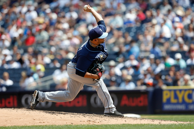 Jun 22, 2013; Bronx, NY, USA;  Tampa Bay Rays relief pitcher Alex Torres (54) delivers a pitch during the fifth inning against the New York Yankees at Yankee Stadium.  Mandatory Credit: Anthony Gruppuso-USA TODAY Sports