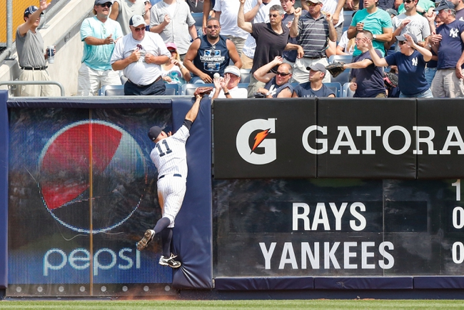 Jun 22, 2013; Bronx, NY, USA;  New York Yankees center fielder Brett Gardner (11) is unable to catch a ball hit for a grand slam by Tampa Bay Rays right fielder Wil Myers (not pictured) during the sixth inning at Yankee Stadium.  Mandatory Credit: Anthony Gruppuso-USA TODAY Sports