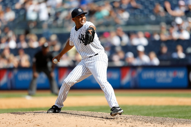 Jun 22, 2013; Bronx, NY, USA;  New York Yankees relief pitcher Mariano Rivera (42) pitches during the ninth inning against the Tampa Bay Rays at Yankee Stadium.  Yankees won 7-5.  Mandatory Credit: Anthony Gruppuso-USA TODAY Sports