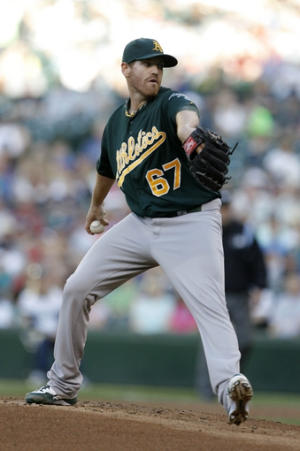 Jun 22, 2013; Seattle, WA, USA; Oakland Athletics pitcher Dan Straily (67) throws against the Seattle Mariners during the first inning at Safeco Field. Mandatory Credit: Joe Nicholson-USA TODAY Sports