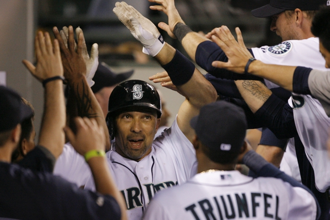 Jun 22, 2013; Seattle, WA, USA; Seattle Mariners left fielder Raul Ibanez (28) is congratulated in the dugout after hitting a three-run homer against the Oakland Athletics during the seventh inning at Safeco Field. Mandatory Credit: Joe Nicholson-USA TODAY Sports
