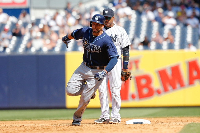 Jun 23, 2013; Bronx, NY, USA; Tampa Bay Rays first baseman James Loney (21) heads to third during the sixth inning against the New York Yankees at Yankee Stadium.  Mandatory Credit: Anthony Gruppuso-USA TODAY Sports