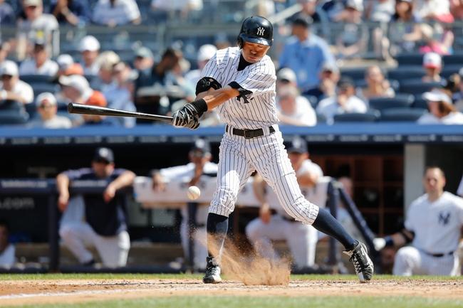 Jun 23, 2013; Bronx, NY, USA;  New York Yankees right fielder Ichiro Suzuki (31) reaches on infield single to pitcher during the fifth inning against the Tampa Bay Rays Yankee Stadium.  Mandatory Credit: Anthony Gruppuso-USA TODAY Sports