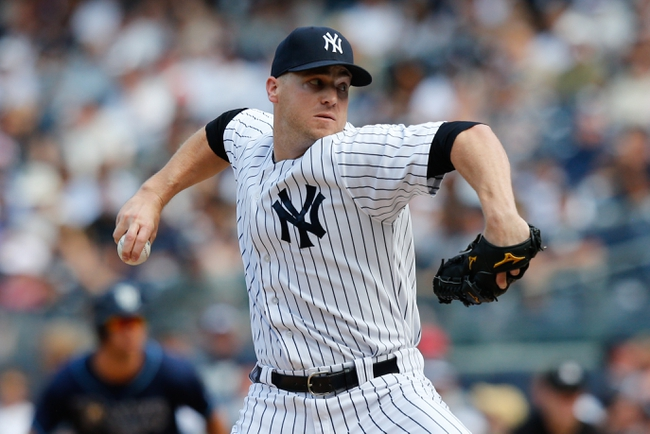 Jun 23, 2013; Bronx, NY, USA;  New York Yankees relief pitcher Shawn Kelley (27) pitches during the seventh inning against the Tampa Bay Rays at Yankee Stadium.  Tampa won 3-1.  Mandatory Credit: Anthony Gruppuso-USA TODAY Sports