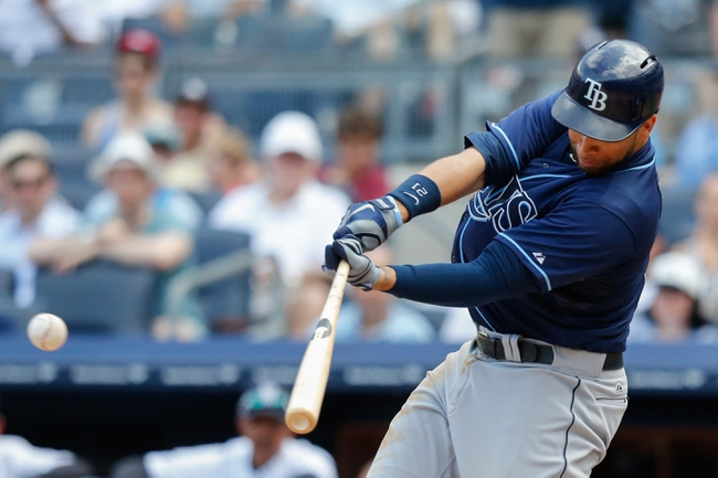 Jun 23, 2013; Bronx, NY, USA;  Tampa Bay Rays first baseman James Loney (21) singles to center allowing two runners to score during the seventh inning against the New York Yankees at Yankee Stadium.  Tampa won 3-1.  Mandatory Credit: Anthony Gruppuso-USA TODAY Sports