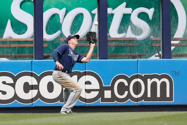 Jun 23, 2013; Bronx, NY, USA;  Tampa Bay Rays left fielder Kelly Johnson (2) fields a ball for an out during the seventh inning against the New York Yankees at Yankee Stadium.  Tampa won 3-1.  Mandatory Credit: Anthony Gruppuso-USA TODAY Sports