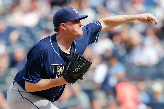Jun 23, 2013; Bronx, NY, USA; Tampa Bay Rays relief pitcher Jake McGee (57) delivers a pitch during the seventh inning against the New York Yankees at Yankee Stadium.  Tampa won 3-1.  Mandatory Credit: Anthony Gruppuso-USA TODAY Sports