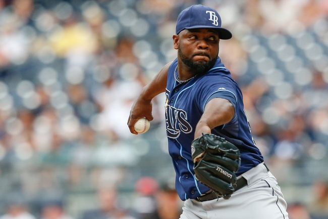 Jun 23, 2013; Bronx, NY, USA; Tampa Bay Rays relief pitcher Fernando Rodney (56) pitches during the ninth inning against the New York Yankees at Yankee Stadium.  Tampa won 3-1.  Mandatory Credit: Anthony Gruppuso-USA TODAY Sports