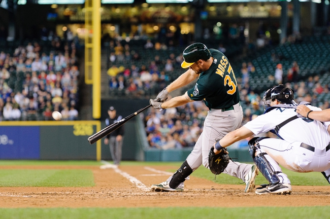Jun 23, 2013; Seattle, WA, USA; Oakland Athletics first baseman Brandon Moss (37) hits a single against the Seattle Mariners during the 6th inning at Safeco Field. Mandatory Credit: Steven Bisig-USA TODAY Sports