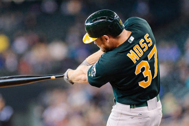 Jun 23, 2013; Seattle, WA, USA; Oakland Athletics first baseman Brandon Moss (37) hits a solo home run against the Seattle Mariners during the 8th inning at Safeco Field. Mandatory Credit: Steven Bisig-USA TODAY Sports