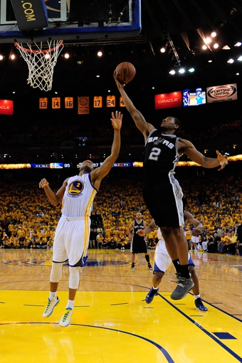 May 12, 2013; Oakland, CA, USA; San Antonio Spurs small forward Kawhi Leonard (2, right) grabs a rebound against Golden State Warriors point guard Jarrett Jack (2, left) during the fourth quarter in game four of the second round of the 2013 NBA Playoffs at Oracle Arena. The Warriors defeated the Spurs 97-87 in overtime. Mandatory Credit: Kyle Terada-USA TODAY Sports