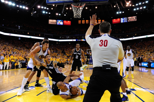 May 12, 2013; Oakland, CA, USA; Golden State Warriors center Andrew Bogut (12), San Antonio Spurs shooting guard Danny Green (4), Warriors point guard Jarrett Jack (2, left), Spurs small forward Kawhi Leonard (2), and Warriors small forward Draymond Green (23) look at referee John Goble (30) during the fourth quarter in game four of the second round of the 2013 NBA Playoffs at Oracle Arena. The Warriors defeated the Spurs 97-87 in overtime. Mandatory Credit: Kyle Terada-USA TODAY Sports