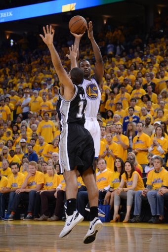 May 12, 2013; Oakland, CA, USA; Golden State Warriors small forward Harrison Barnes (40) shoots the ball against San Antonio Spurs point guard Gary Neal (14) during the fourth quarter in game four of the second round of the 2013 NBA Playoffs at Oracle Arena. The Warriors defeated the Spurs 97-87 in overtime. Mandatory Credit: Kyle Terada-USA TODAY Sports