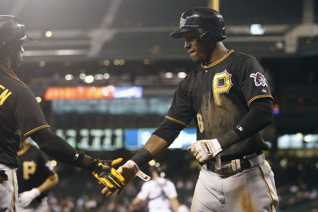 Jun 25, 2013; Seattle, WA, USA; Pittsburgh Pirates left fielder Starling Marte (6) returns to the dugout after scoring a run against the Seattle Mariners during the first inning at Safeco Field. Mandatory Credit: Joe Nicholson-USA TODAY Sports