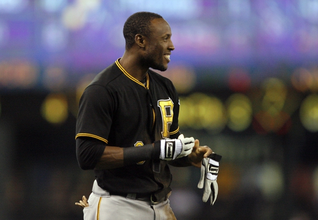 Jun 25, 2013; Seattle, WA, USA; Pittsburgh Pirates left fielder Starling Marte (6) smiles after sliding safely for a triple against the Seattle Mariners during the first inning at Safeco Field. Mandatory Credit: Joe Nicholson-USA TODAY Sports