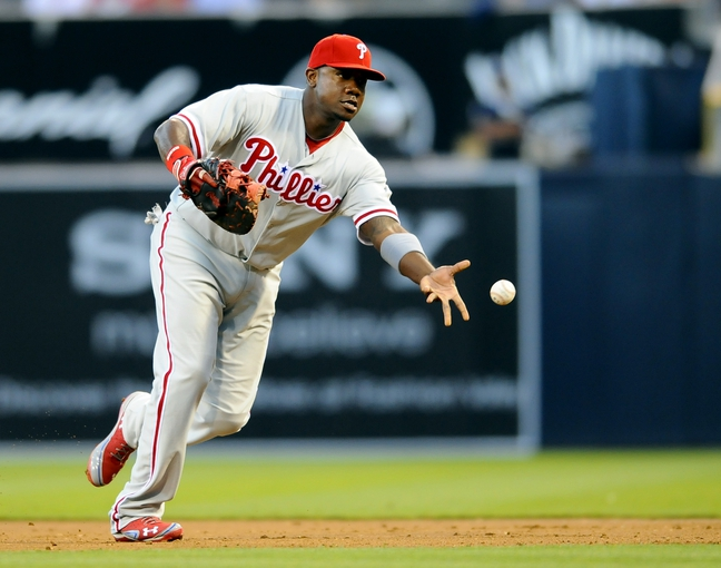 June 25, 2013; San Diego, CA, USA; Philadelphia Phillies first baseman Ryan Howard (6) tosses the ball to first base for an out during the second inning against the San Diego Padres at Petco Park. Mandatory Credit: Christopher Hanewinckel-USA TODAY Sports