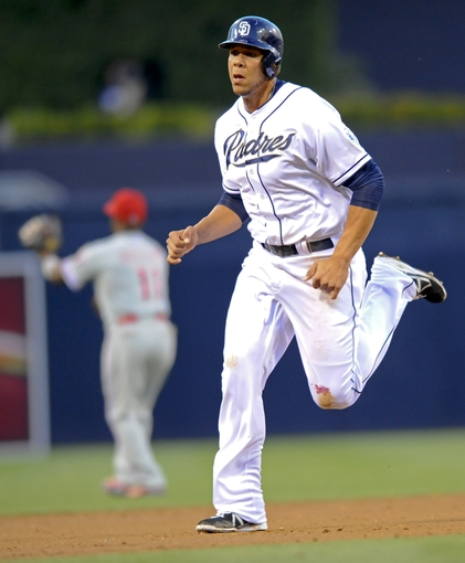 June 25, 2013; San Diego, CA, USA; San Diego Padres first baseman Kyle Blanks (88) advances to third base after a hit during the second inning against the Philadelphia Phillies at Petco Park.  Mandatory Credit: Christopher Hanewinckel-USA TODAY Sports