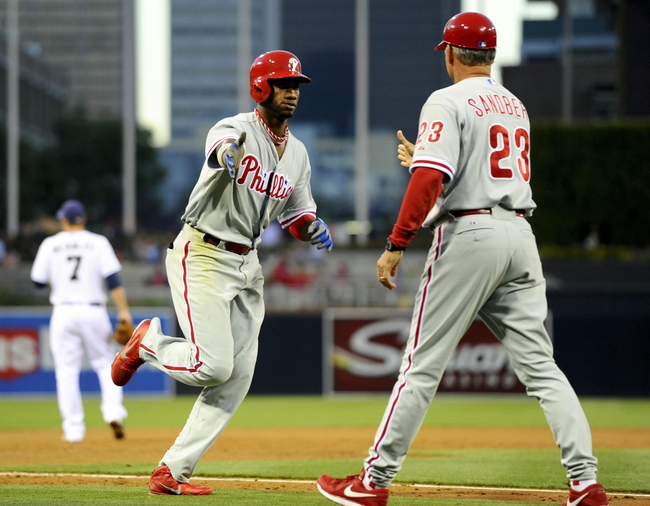 June 25, 2013; San Diego, CA, USA; Philadelphia Phillies left fielder Domonic Brown (9) is congratulated by third base coach Ryne Sandberg (23) following a three-run home run during the third inning against the San Diego Padres at Petco Park. Mandatory Credit: Christopher Hanewinckel-USA TODAY Sports